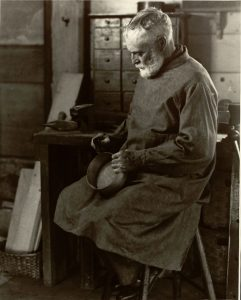A Shaker Box Maker working at his craft.